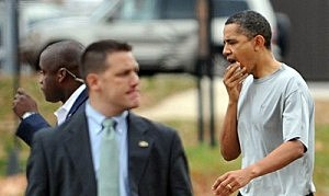 President Obama checks out his lip after a basketball injury.