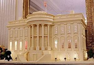 "A replica of the White House made from 400-pounds of gingerbread, white chocolate and marzipan is on display in the State Dining Room during the first viewing of the 2011 White House Christmas decorations November 30, 2011 in Washington, DC. The theme, ""Shine, Give, Share,"" runs throught the White House with a 400-pound White House Gingerbread House and 37 Christmas trees, including the official 18-foot 6-inch balsam fir tree in the Blue Room that honors Blue Star military families."