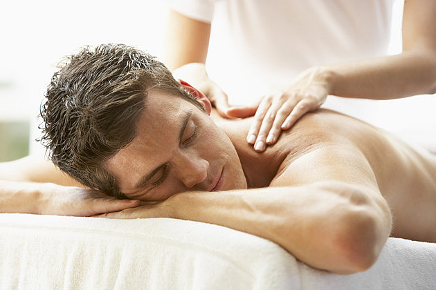 Man Enjoying Massage At Spa