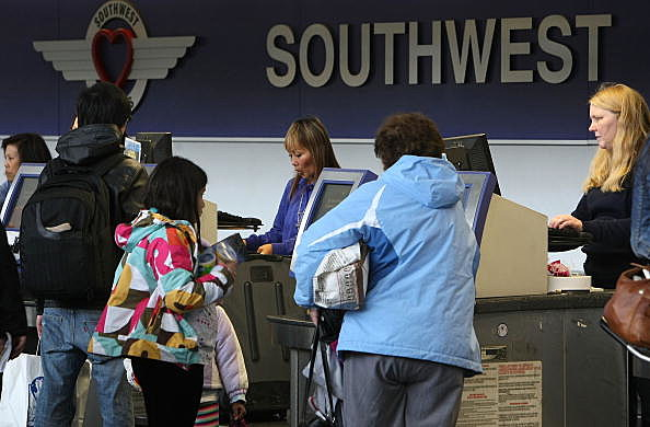 SAN FRANCISCO - JANUARY 21: Southwest Airlines customers check in for flights January 21, 2010 at San Francisco International Airport in San Francisco, California. Southwest reported fourth quarter earnings of $116 million or 16 cents a share compared to a loss of $56 million or 24 cents a share one year ago.  (Photo by Justin Sullivan/Getty Images)