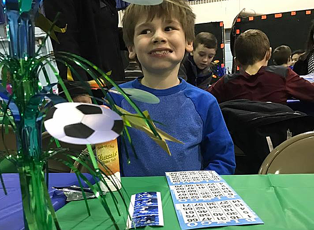 My son at a bingo night, obviously having a blast.