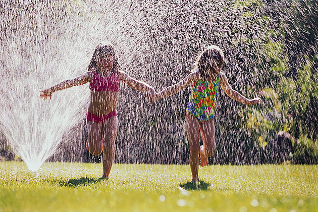 Young Friends in Sprinkler